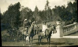 Dola Dunsmuir and gentleman on horses at Hatley Park