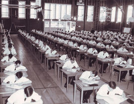 Cadets writing examinations in the gymnasium